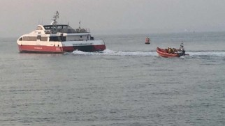 Lifeboat following in the stream of the Red Jet ferry