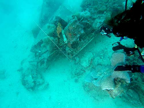 val thal-slocum inspecting avenger wreckage in palau for bentprop