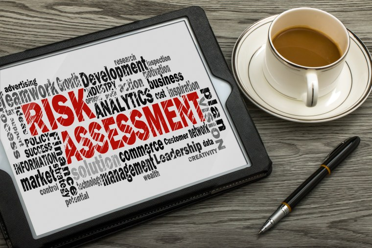 Picture of tablet with risk assessment text