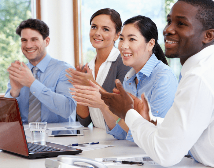 picture of team members clapping
