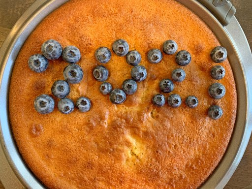 The year 2021 written out in blueberries on a Vasilopita cake