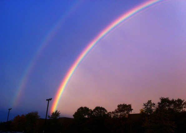 Double rainbow at sunset in blue and purple sky