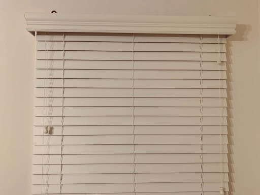 White window blinds in a white room