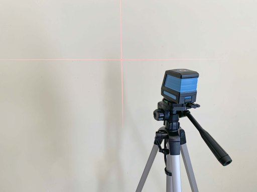 Laser level attached to a tripod