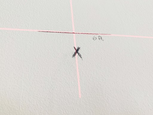 Laser level cross hairs on a wall
