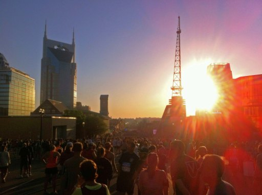 Sunrise illuminating runners at the start line of the Rock 'N' Roll Nashville marathon in Nashville, Tennessee