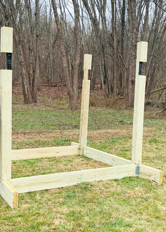 The four 6x6 posts of a playground tower secured to the playground base