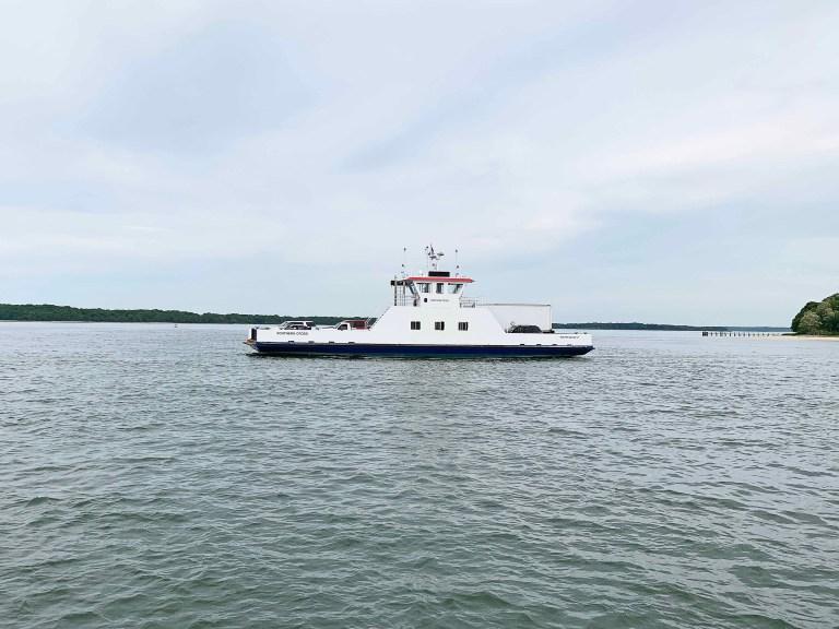 White ferry boat crossing water
