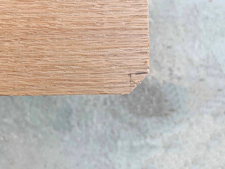 Light-colored wood with black pencil markings