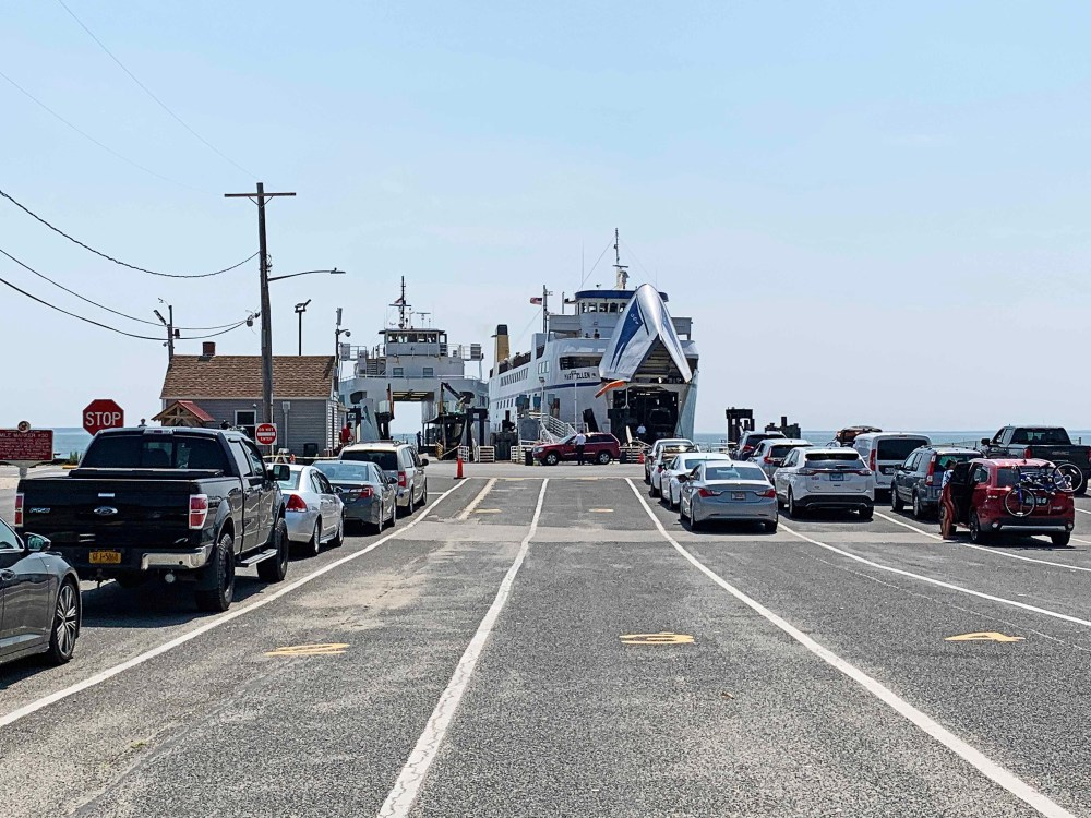 Cars lined up in front of ferry boats