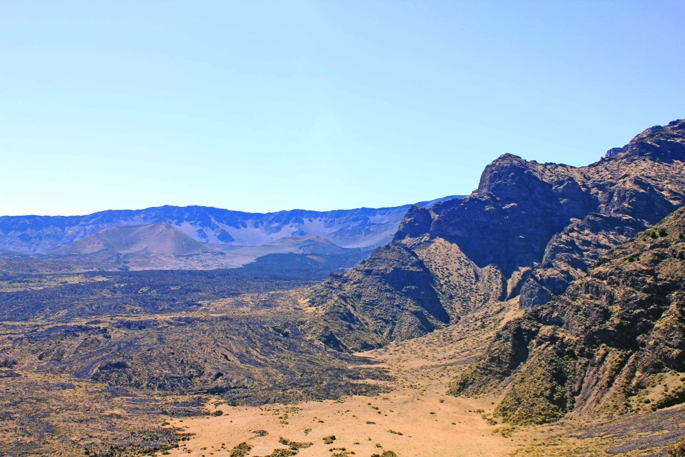 Desert-like mountainous terrain with blue skies