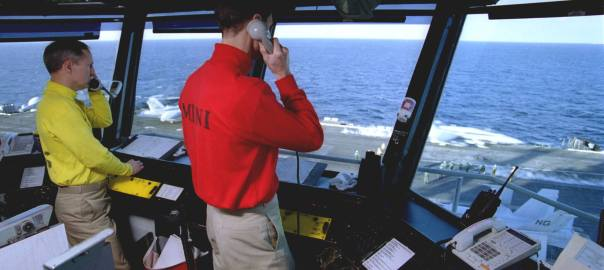 The Air Boss oversees operations on the deck of an aircraft carrier