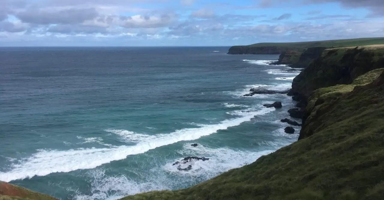 Green cliffs beside the ocean