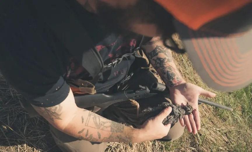 A hunter holds a California quail