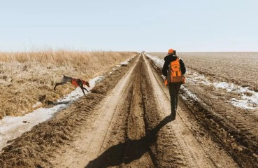 A female bird hunter in Nebraska with ger German shorthaired pointer