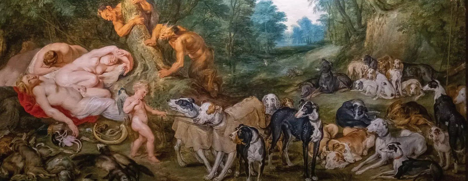 A historic painting depicting some of the first hunting dogs.