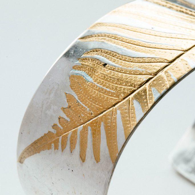 Polished silver with gold fern bracelet