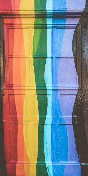 A door upon which a wavy rainbow has been painted
