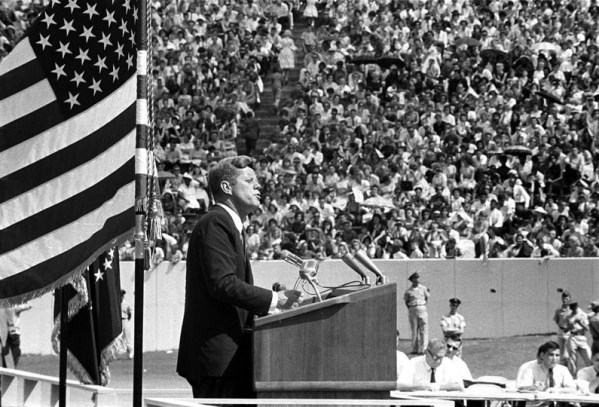 """President Kennedy speaking at Rice University on September 12, 1962. In this speech he stated stated, """"We choose to go to the Moon in this decade and do the other things, not because they are easy, but because they are hard."""" (Kennedy Library)"""