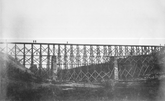 """The Richmond, Fredericksburg, and Potomac Railroad's Potomac Creek Bridge after reconstruction. In May 1862, using unskilled infantry, Haupt rebuilt this bridge in only nine rainy days with considerably more than """"cornstalks and beanpoles."""" (64-CV-268)"""