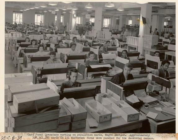 Original caption: Card punch operators working on population cards, Negro Section. Approximately 328,341,293 cards in 151 forms were punched for the decennial census. National Archives Identifier: 7741404