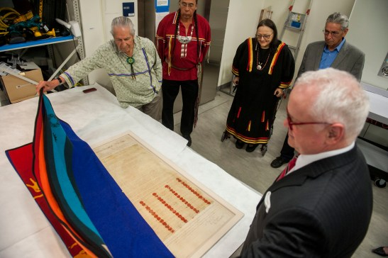 """From left: Faithkeeper of the Turtle Clan of the Onondaga Nation of the Haudenosaunee Confederacy Oren Lyons; Tadodaho of the Haudenosaunee Confederacy Chief Sidney Hill; Suzan Harjo (Cheyenne and Hodulgee Muscogee), guest curator of the """"Nation to Nation"""" exhbition; Kevin Gover (Pawnee), director of the National Museum of the American Indian; and Jim Gardner, Executive for Legislative Archives, Presidential Programs, and Museum Programs at the National Archives, welcome the Treaty of Canandaigua to the museum. (Kevin Wolf/AP Images for the Smithsonian's National Museum of the American Indian)"""