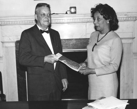 Joseph E. Wood presents a pamphlet to Sara D. Jackson, April 20, 1965 64-NA-2659, Records of the National Archives