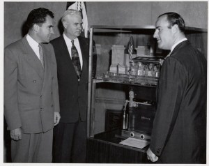 Vice President Nixon, Senator Bricker, and Mr. Mosler view the scale model of the shrine and safe, June 29, 1954. (National Archives Identifier 3493223)