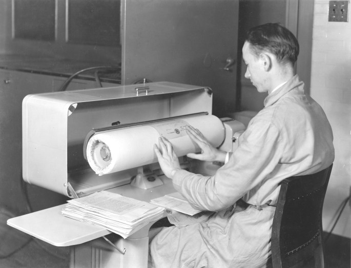 64-NA-168 Large Mangling Iron in Div. of Repair and Preservation, Jan. 1937