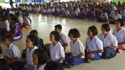 Students meditate for a few minutes after the Flower's Blooming song.