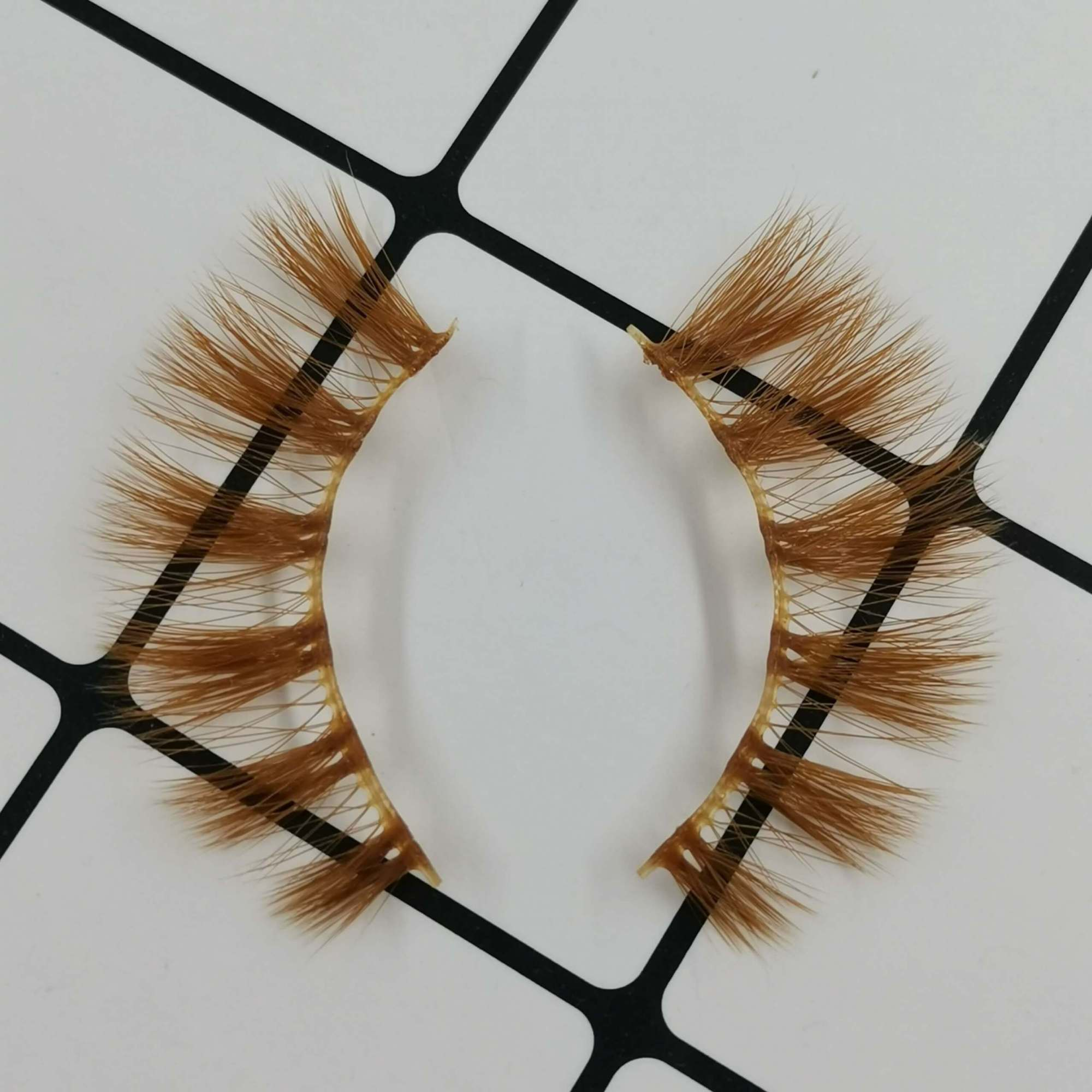 A pair of colored eyelashes for your eye shape and its color is brown. Trust me, ProluxuryLashes brand is the best eyelash supplier
