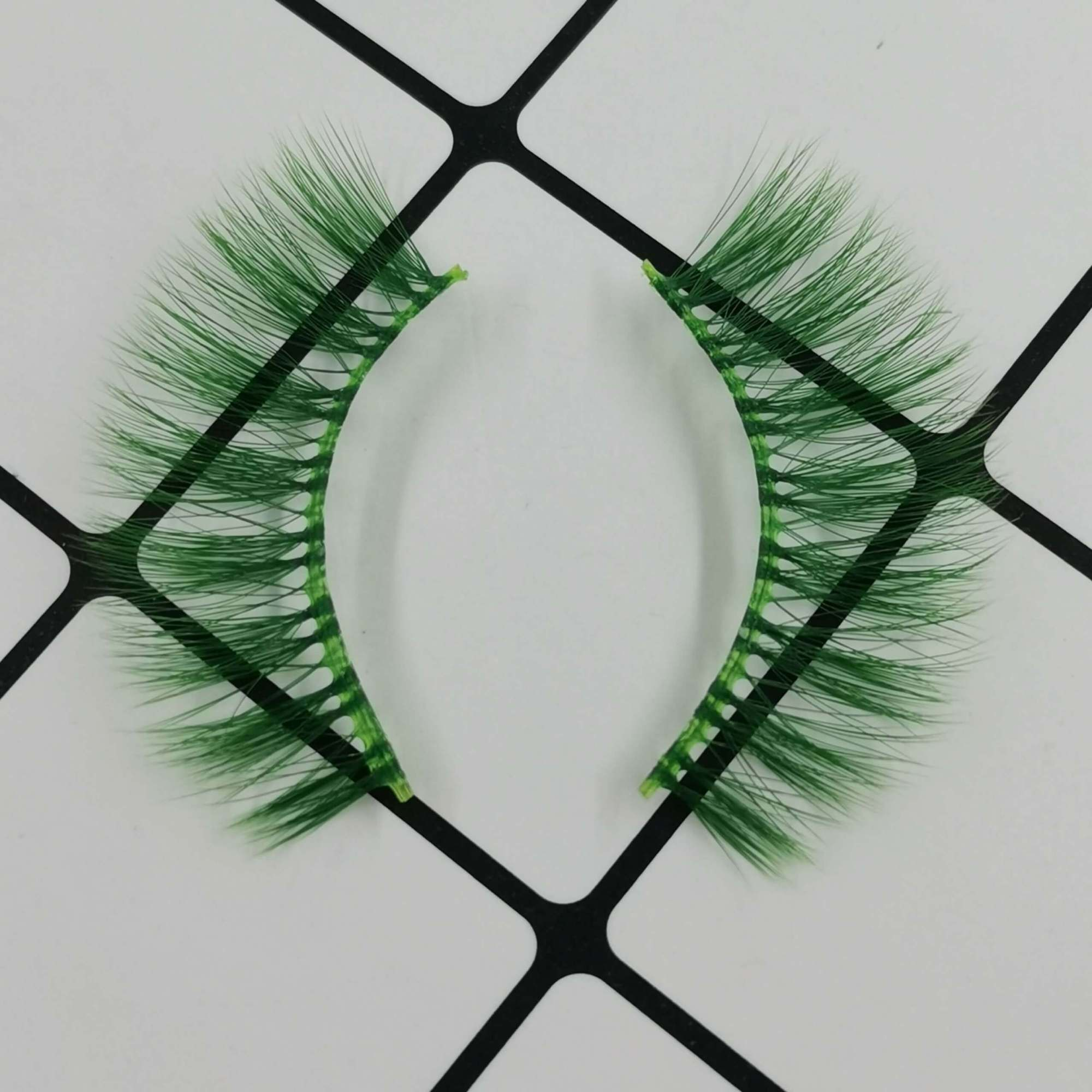 A pair of colored eyelashes for your eye shape and its color is green. Trust me, ProluxuryLashes brand is the best eyelash supplier
