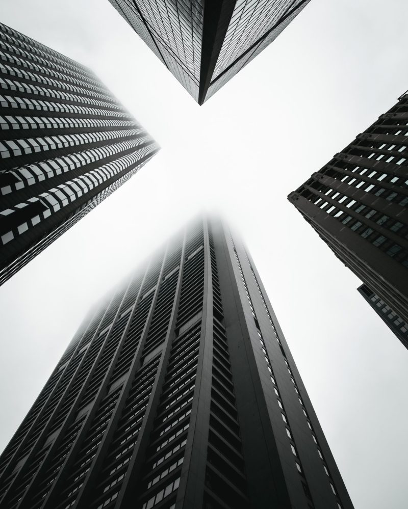 monochrome-photo-of-high-rise-buildings-2539658