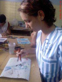 Sabili Rodríguez pintando durante el taller