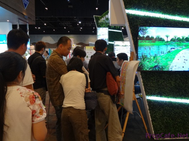 Ekovest Booth - Crowd looking at the Sales Chart