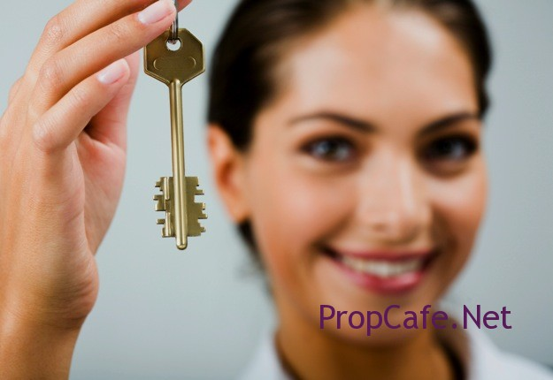 Property-Investment_Lady-with-house-key-in-hand_Mouths-of-Mums