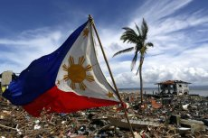 The Philippines flag is blown by the wind in a super devastated view of Tacloban City, Leyte province, Philippines, 13 November 2013. (Photo by Mast Irham/EPA)