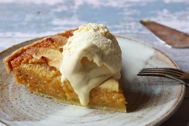 sticky apple treacle tart slice with vanilla ice cream