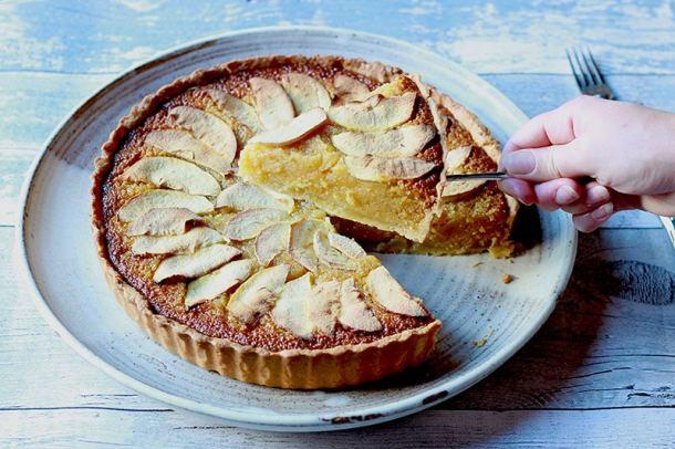 sticky apple treacle tart taking slice
