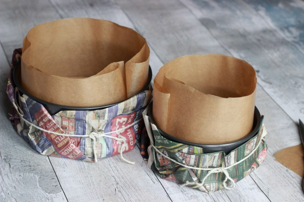 8 inch and 6 inch tins lined and wrapped in newspaper