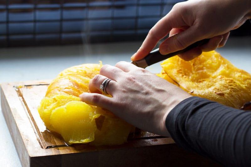 chopping up pumpkin