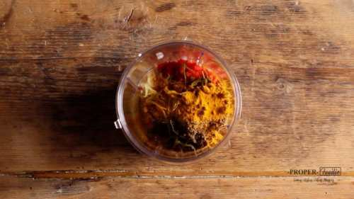 placing thai red paste ingredients in the blender