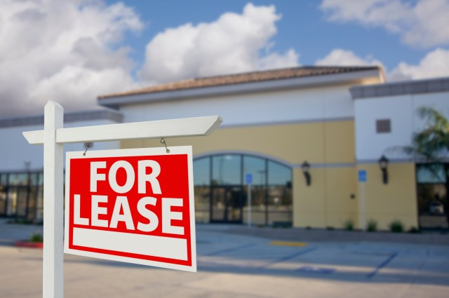 expert marketing strategies for commercial properties on property manager insider sign in front of building
