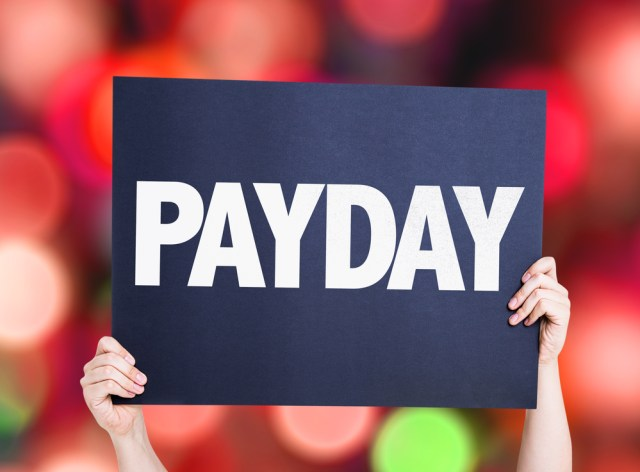 Assistant Property Manger Salary Guide Blog Header With Payday On A Blue Card Over Blurred Background