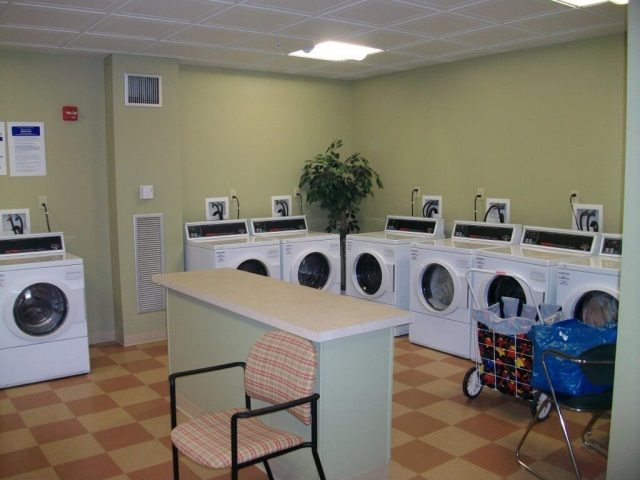 Laundry Room Leases For MultiFamily Property With White Machines