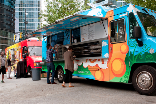 Apartment Residents Odering Food From Food Truck Rally During An Apartment Resident Event