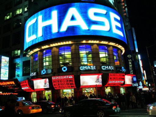 "Colored photograph of front of Chase Manhattan Bank with large sign at top with word ""Chase' and screens below showing stock market. Is Kim Jong-Un in bible prophecy?"