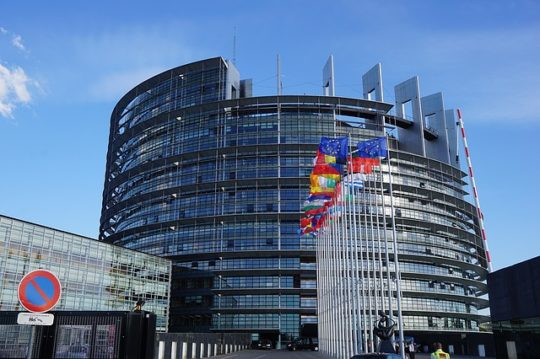 Colored photograph of European Parliament Building with flags of European countries in the front. Is France in prophetic scriptures?