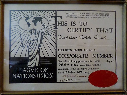 Colored photograph of a framed certificate of corporate membership of a church in  the League of Nations.  It contains  an illustration of  a  female figure, with scales in one hand and sword in the other, symbolically  representing justice. God's Final  Warning.