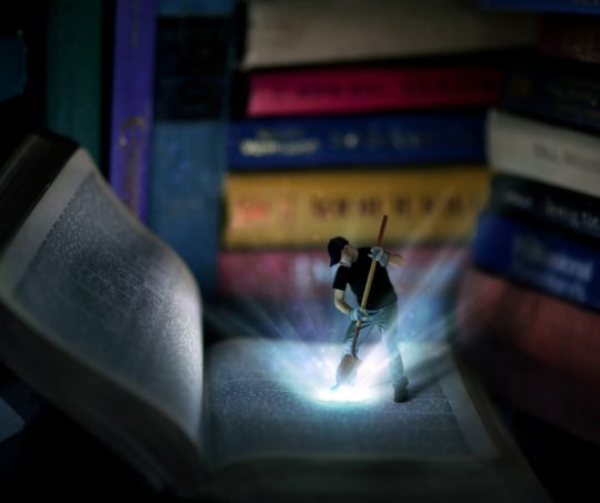 Colored simulation of a young man in a black baseball cap exposing light as he digs with a shovel into a huge Bible. Stack of enormous books in the background. Israel embraces NATO.